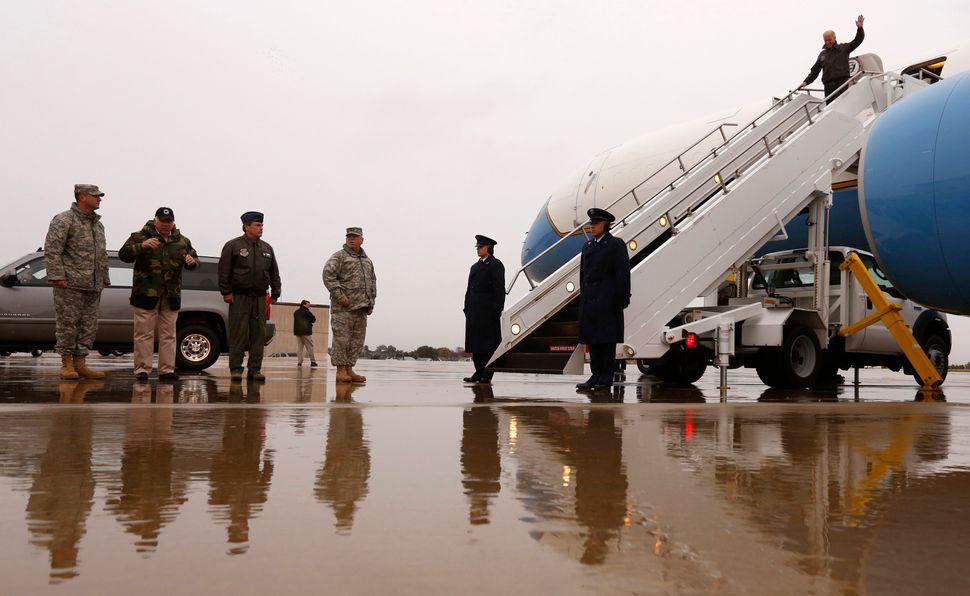 U.S. Vice President Joe Biden waves upon his arrival in Wilmington, Delaware November 7, 2012. Biden will spend the night at