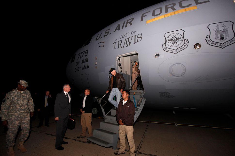 U.S. Vice President Joe Biden disembarks from the plane as he arrives in Baghdad, November 29, 2011. U.S. Vice President Bide