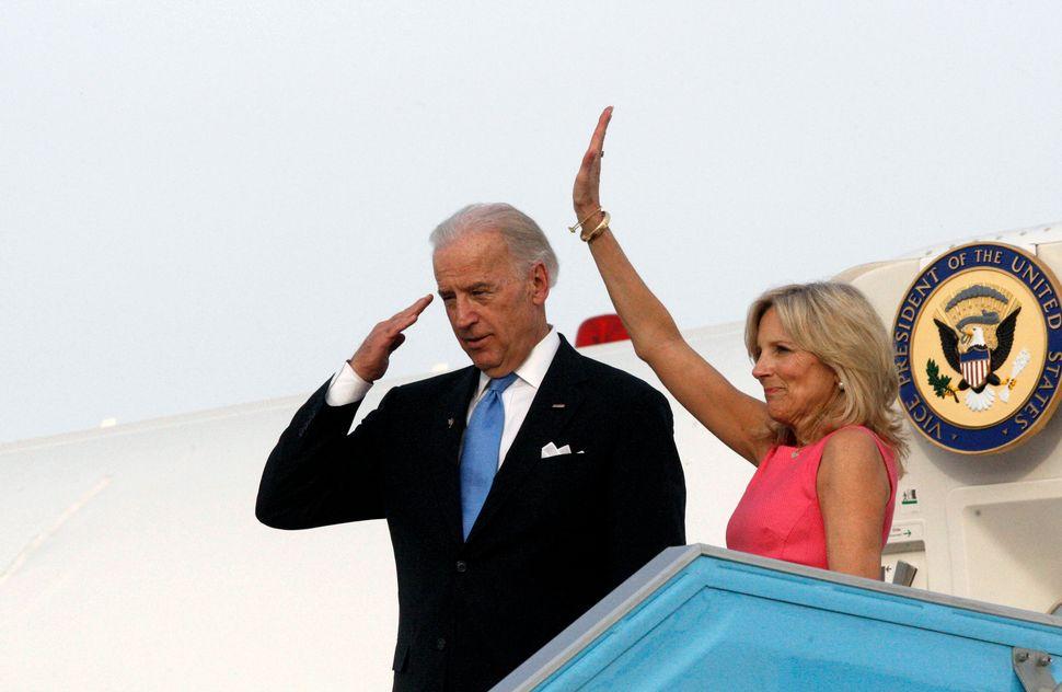 U.S. Vice President Joe Biden (L) and his wife Jill gesture before boarding a plane at Ben Gurion International airport near