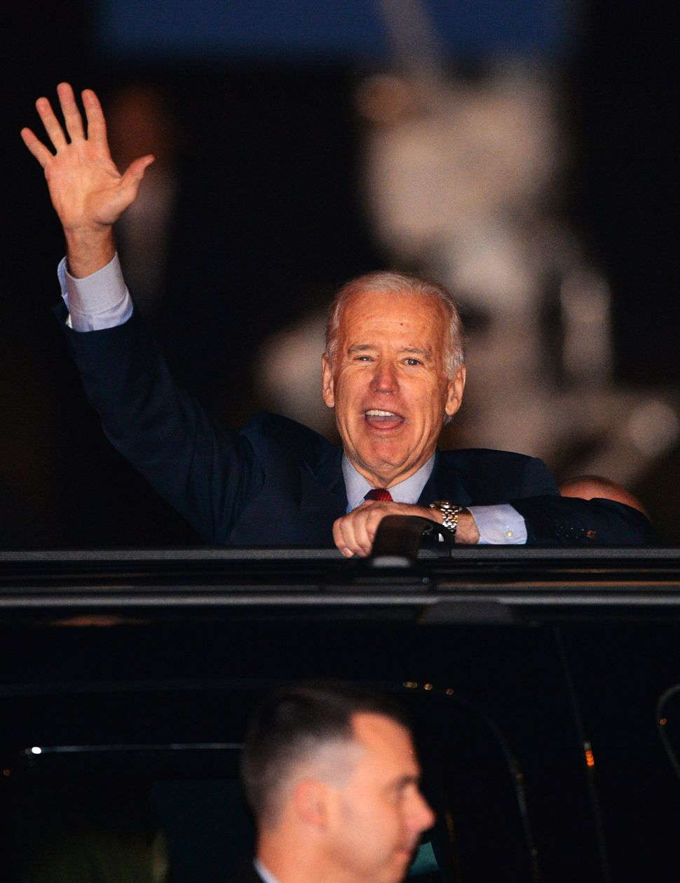 US Vice President Joe Biden waves upon his arrival at the Tokyo International Airport on December 1, 2013 on the first leg of