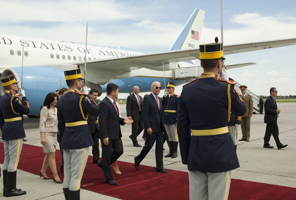 US Vice President Joe Biden (C,R) walks next to Romanian Foreign Minister Titus Corlatean (C,L) after arriving at the 'Henry
