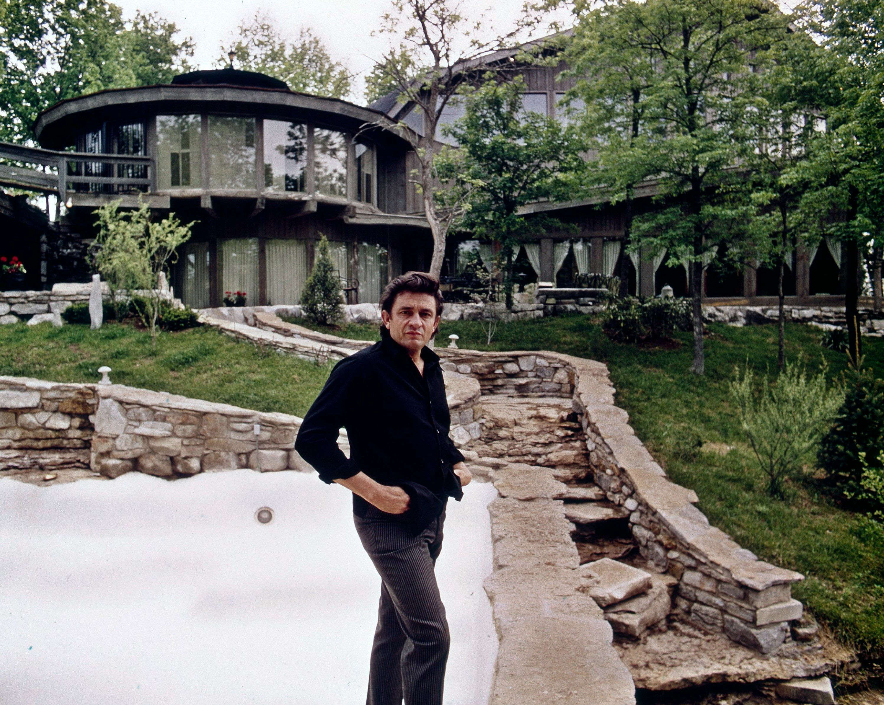 Johnny Cash outside his home Hendersonville, TN home in 1969. The original house burned down in 2007.