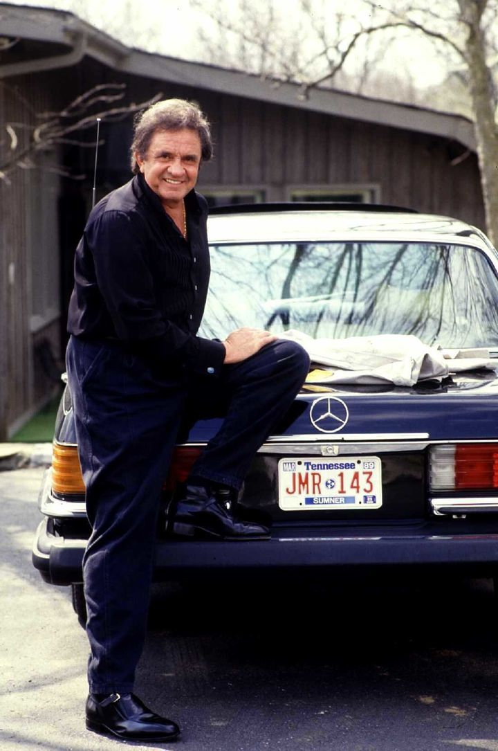 Johnny Cash shows off a car in the driveway, 1988.