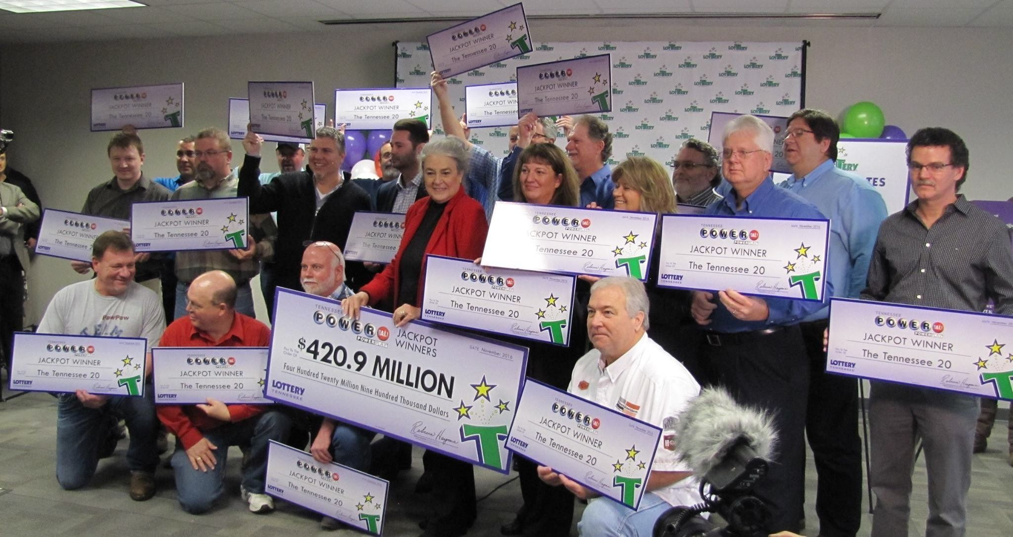 This group of 20 longtime co-workers will split a $421 million Powerball jackpot prize.