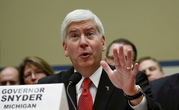 Michigan Gov. Rick Snyder testifies at a House Oversight and Government Reform hearing. Snyder is pushing back against&n