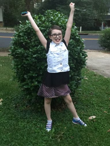 <p><em>Victory pose.                                               Our gender creative son's personality shines through when he's allowed to wear the clothing he likes. </em></p>