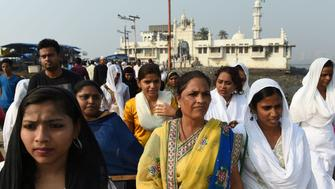 Indian women leave after visiting the inner sanctum of the Haji Ali Dargah in Mumbai on November 29, 2016. Dozens of women entered the inner sanctum of a historic mosque in India on November 29 after winning a bitter legal battle for a ban on female worshippers to be lifted. The Haji Ali Dargah trust agreed in October 2016 to lift the ban on women entering the landmark mausoleum off the coast of Mumbai after a group of women campaigners launched a legal case.  / AFP / PUNIT PARANJPE        (Photo credit should read PUNIT PARANJPE/AFP/Getty Images)