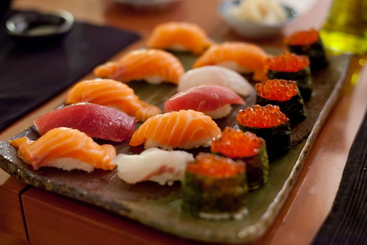 Photo of sushi, a dish that includes raw fish. Foodborne trematodiases are caused by worms, which people get b