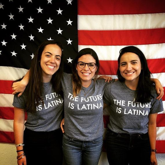 "$25.00, Etsy. <a href=""https://www.etsy.com/listing/466095184/the-future-is-latina-t-shirt-xs?ga_order=most_relevant&ga_s"