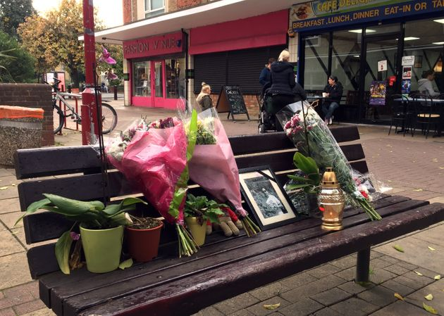 Flowers and candles are seen in a memorial to Arkadiusz Jozwik in