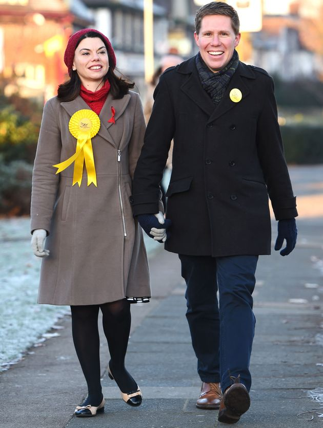 Liberal Democrat candidate Sarah Olney arrives with her husband Ben to vote at a polling station in Richmond