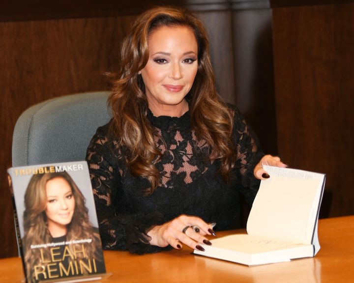 "Remini signing copies of her book, ""Troublemaker: Surviving Hollywood and Scientology,"" in Dec. 2015."