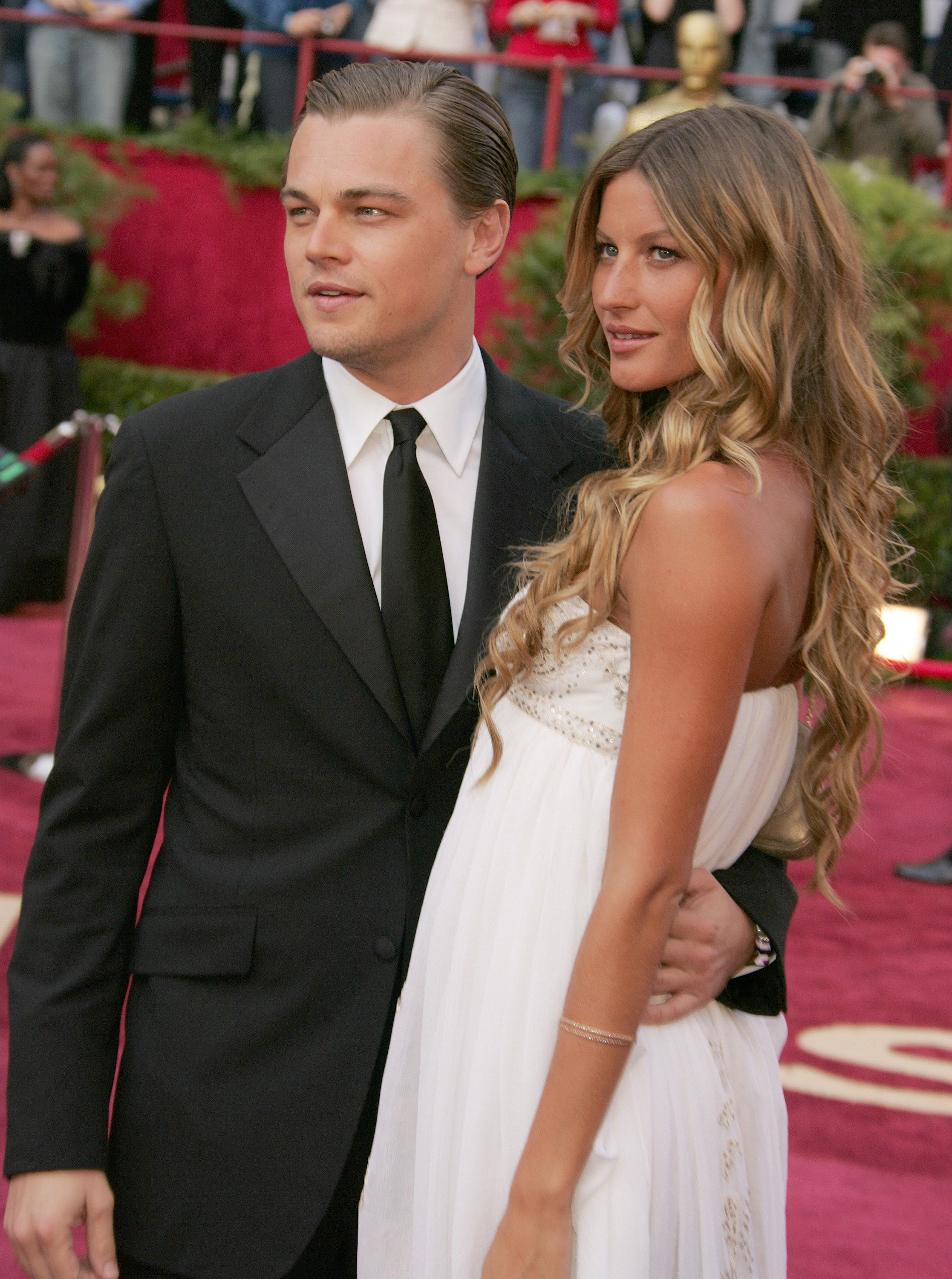Leonardo DiCaprio, nominee Best Actor in a Leading Role for 'The Aviator,' and Gisele Bundchen (Photo by Jeffrey Mayer/WireImage)
