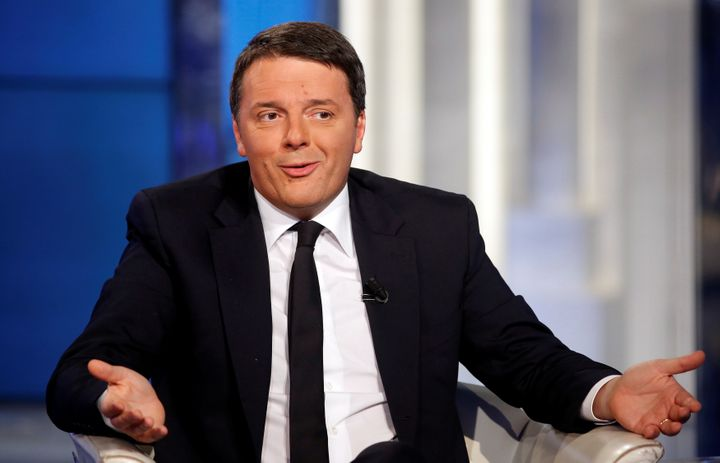 """Italy's Prime Minister Matteo Renzi gestures as he attends television talk show """"Porta a Porta"""" (Door to Door) in Rome."""