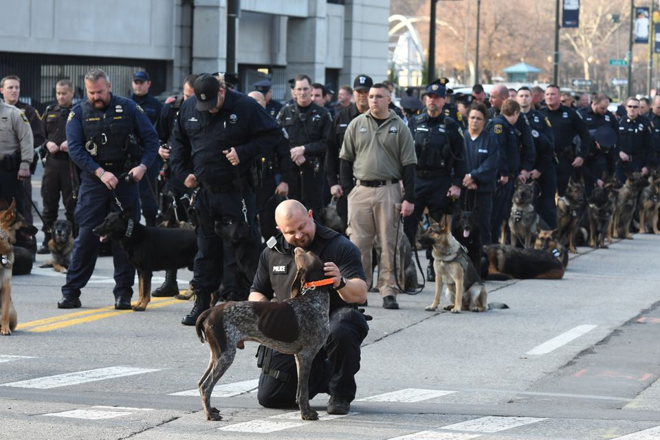 Wolverine, one of two dogs that belonged to Wayne State University Police Officer Collin Rose, is seen ahead of Rose's m