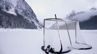 Hockey Stick, Skates And Net On Lake Louise, Banff National Park