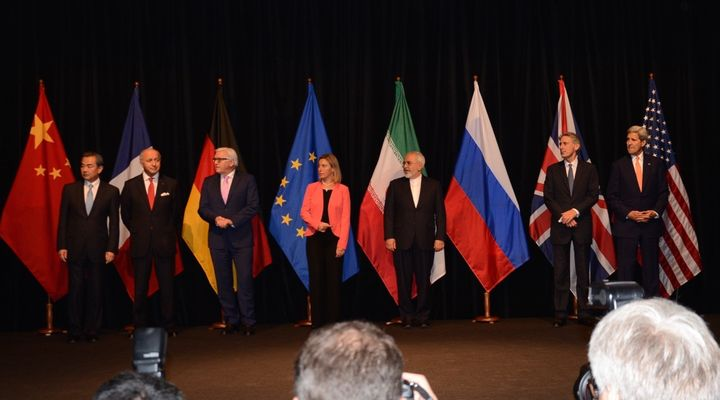 Representatives ofthe U.S., U.K., Iran, European Union, Germany, France and China pose for a photograph after finalizin