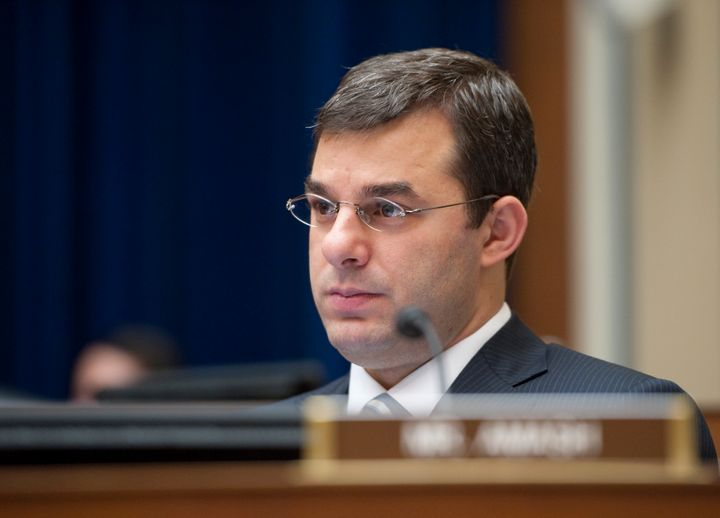Rep. Justin Amash (R-Mich.) listens during a House Oversight and Government Reform Committee hearing.
