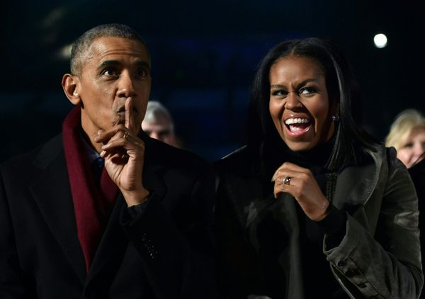 The president and first lady spread their cheer at the tree-lighting.