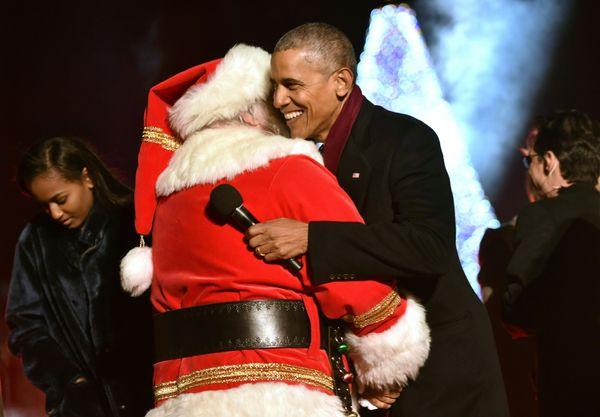 A hug for the holidays between Santa and President Barack Obama.