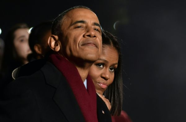 President Barack Obama and first lady Michelle Obama take in the festivities.