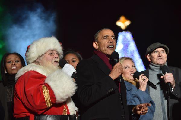 "President Barack Obama is surrounded by celebritiesas he sings ""Jingle Bells."""