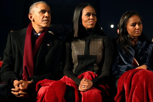 President Barack Obama with his wife, Michelle, and daughter Sasha.