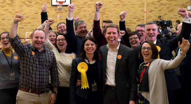 Newly elected MP for Richmond Park Sarah Olney (C) celebrates with her husband Ben (2nd