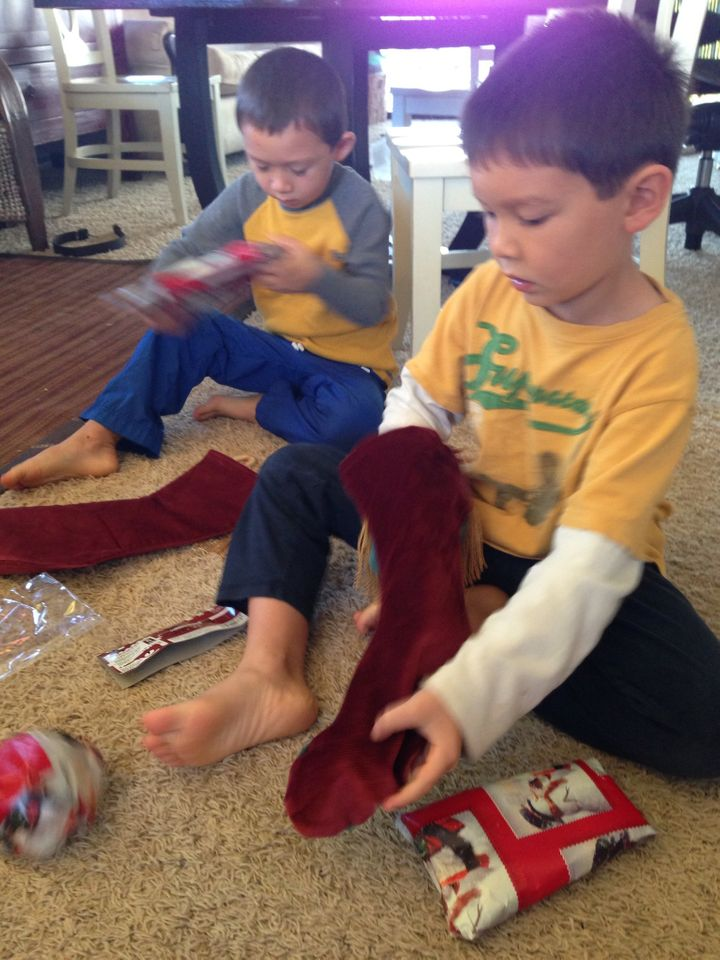 <p>Boys Rip Open Christmas Stocking Gifts at Frenzied Pace</p>