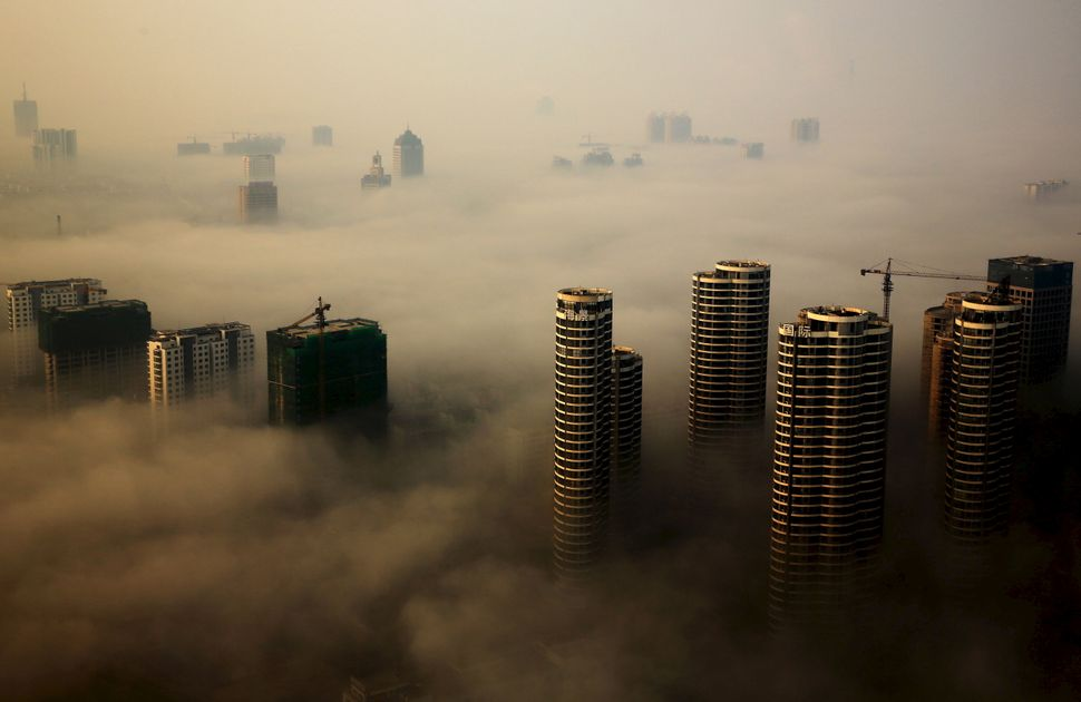 Buildings in construction on a hazy day in Rizhao, Shandong province, China. Oct. 18, 2015.