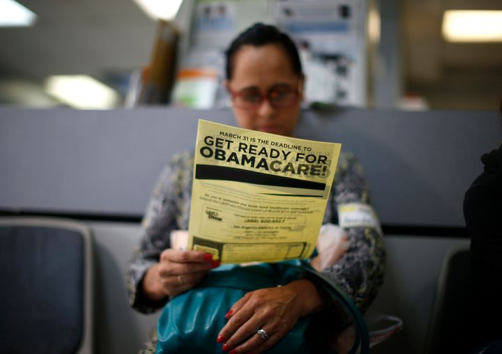 Arminda Murillo, 54, reads a leaflet on Obamacare at a health insurance enrollment event in Cudahy, California, on March 27,