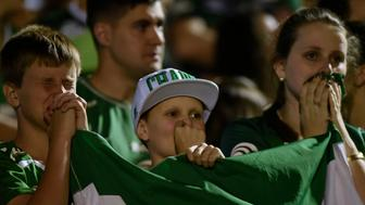 Brazil's Chapecoense football club fans participate in a tribute to the players killed in a plane crash Monday night in Colombia, at the club's stadium in Chapeco, Santa Catarina, Brazil, on November 30, 2016.   Fans mourned Wednesday for a Brazilian football team decimated in a plane crash that killed 71 people in Colombia, as a recording emerged of the panicked pilot reporting he was out of fuel. / AFP / DOUGLAS MAGNO        (Photo credit should read DOUGLAS MAGNO/AFP/Getty Images)