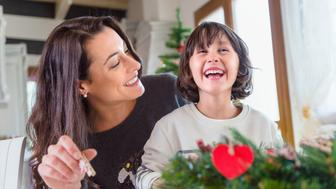 indoors, christmas, lifestyles, christmas decorations, cultures, domestic life, plant, decorating, winter, wreath, toothy smile, laughing, heart shaped, sitting, table, holding, sitting on legs, child, gender blender, stripy, christmas tree