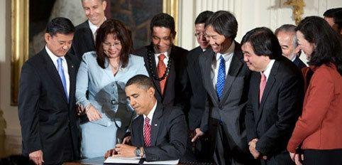 <em>President Obama signing legislation to promote diversity and inclusion in Federal Workforce</em>