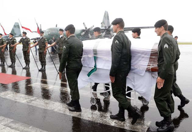 The coffin of one of the 50 members of the football team arrives at Chapeco