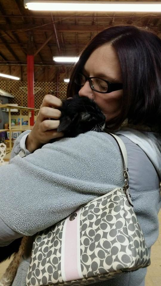 A woman embraces a cat she feared she had lost in the Tennessee wildlfires.