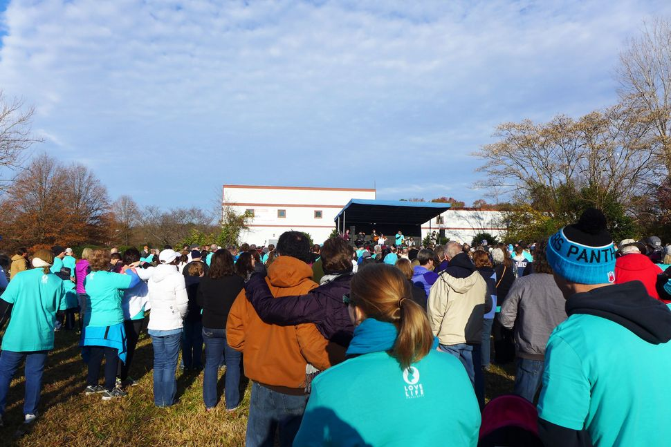 Love Life Charlotte members join in prayer before they begin to march.