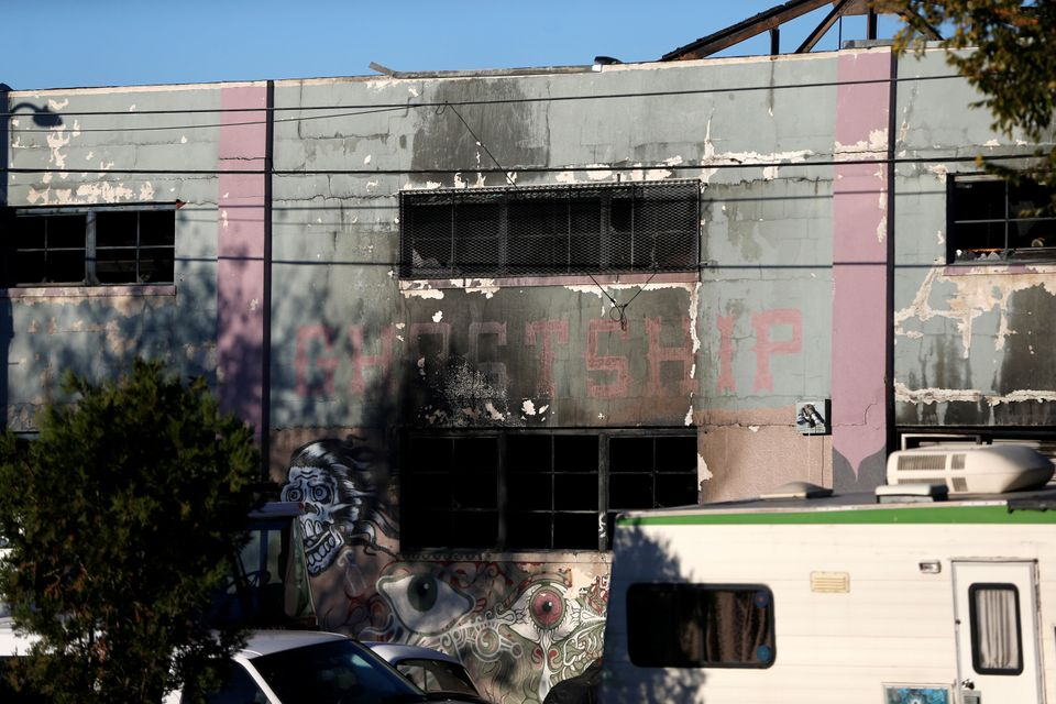 A charred wall is seen outside a warehouse after a fire broke out during an electronic dance party late Friday evening, resul