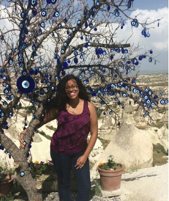 In Cappadocia with a tree covered in evil eye medallions (told you it was my favorite place)