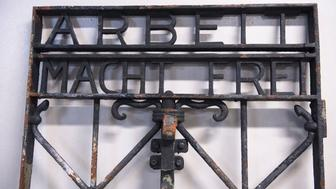 Picture taken on December 3, 2016 in Bergen, shows the iron gate from the former Nazi concentration camp in Dachau, southern Germany, with the slogan 'Arbeit macht frei' ('Work will set you free'), found by the police in Bergen this week, two years after it had been stolen. The gate, stolen from the former Nazi concentration camp Dachau in Germany, was recovered outside Bergen in southwestern Norway this week following an anonymous tip-off.  / AFP / NTB Scanpix / Marit HOMMEDAL / Norway OUT        (Photo credit should read MARIT HOMMEDAL/AFP/Getty Images)