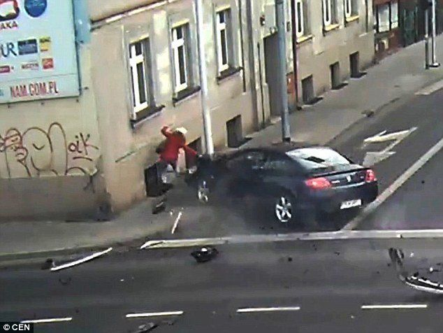 Woman is save from almost certain death when an outofcontrol car is stopped from striking her by a light post