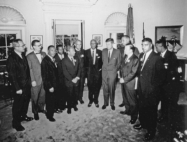 Martin Luther King, Jr. meeting with whites in power to recruit them to fight for his agenda.