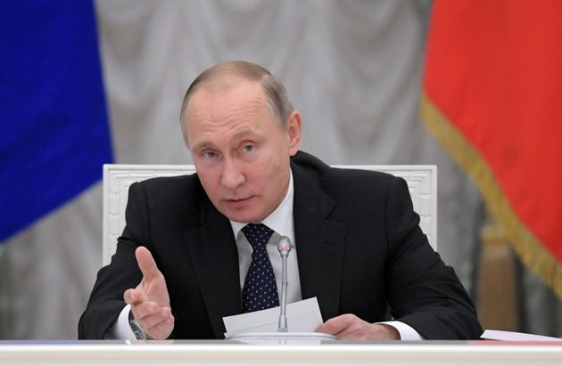Russian President Vladimir Putin chairs a meeting about state funding for science at the Kremlin in Moscow,...
