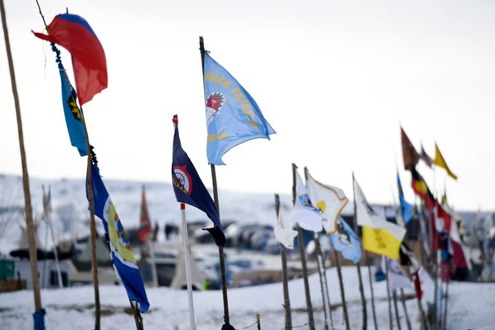 Flags from dozens of nations are on display at Oceti Sakowin Camp on the edge of the Standing Rock Sioux Reservation on Decem