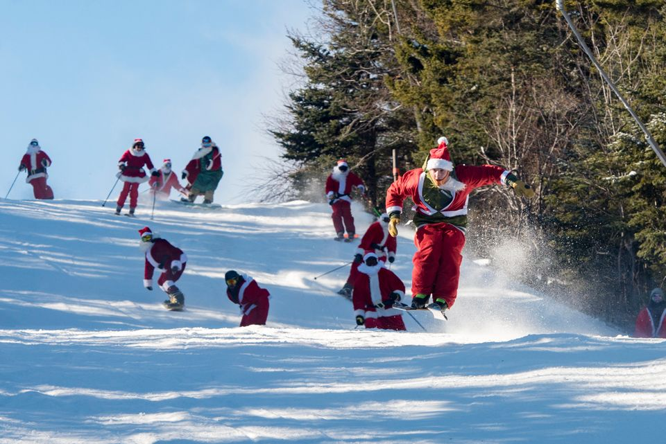 Skiers and snowboarders donning Santa suits and beards hit the slopes for the 17th annual Santa Sunday in Maine.