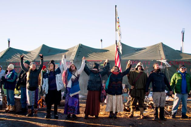 Activists celebrate at Oceti Sakowin Camp on the edge of the Standing Rock Sioux