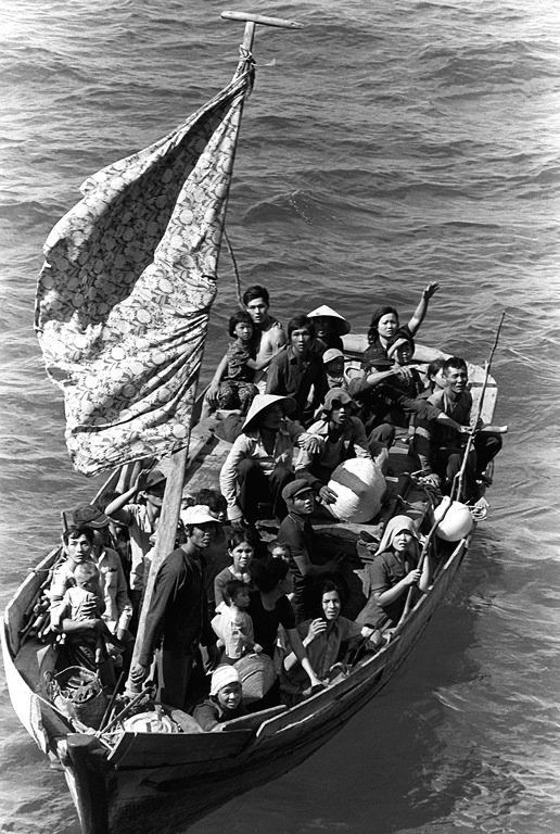 A boat with 35 Vietnamese refugees, waiting to be taken on board a U.S. naval vessel after spending eight days at sea.