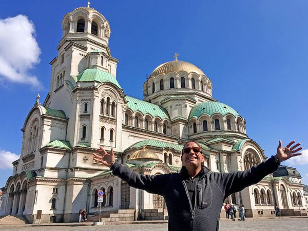 """Andrew Espinosa: """"HIV will never stop me from traveling! This is me at Alexander Nevsky Cathedral. I'm excited to be he"""