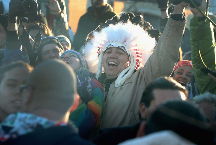 Native American and other activists celebrate.