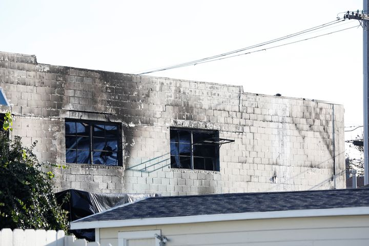 Broken windows are seen after a blaze gutted the warehouse in Oakland, California.